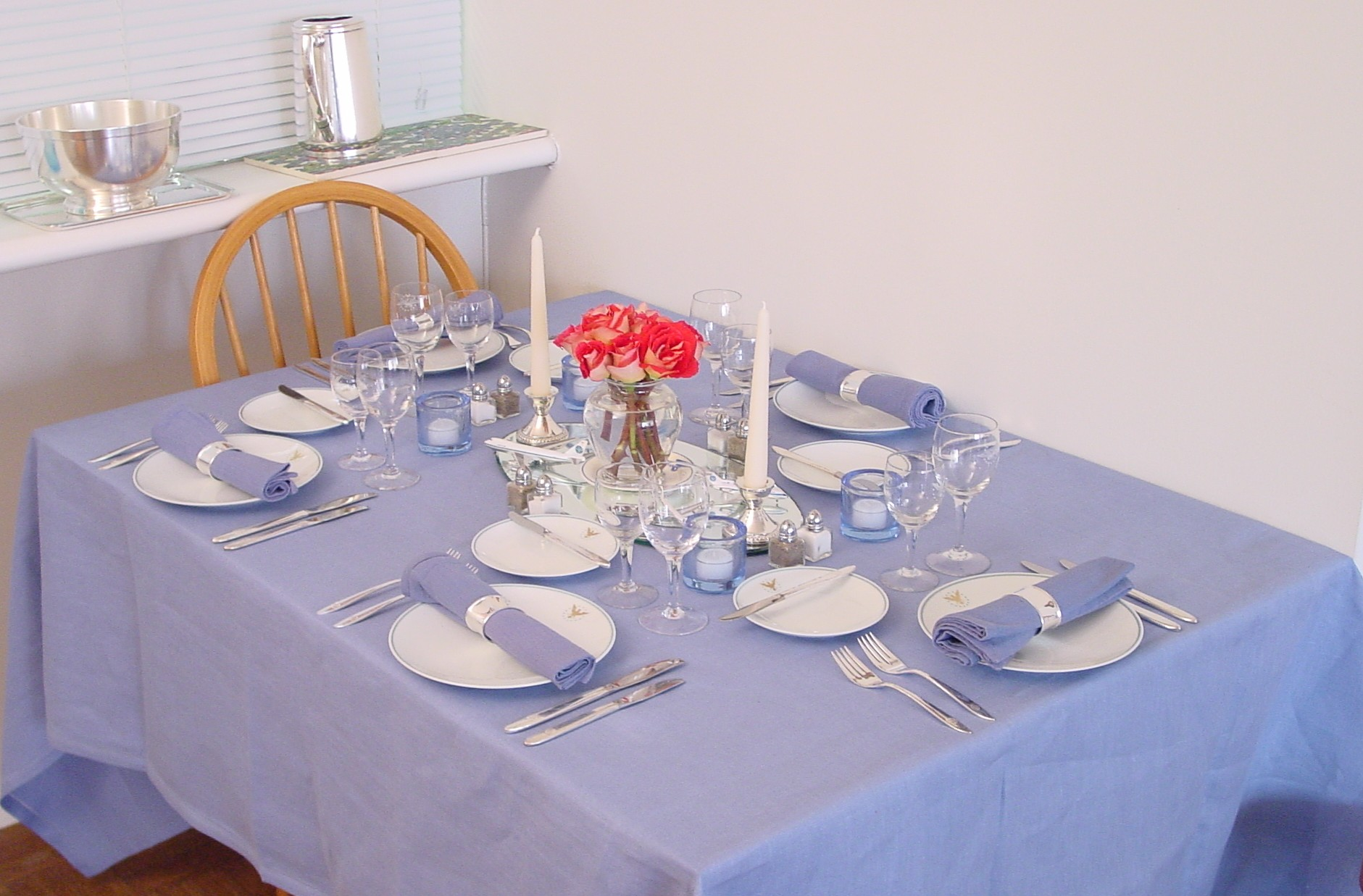 A long shot of a table set with the 1960s Pan Am 'President' pattern by Noritake.