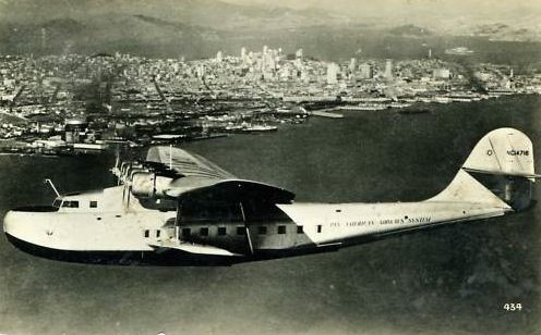 1930s  NC14716 China Clipper in flight above San Francisco