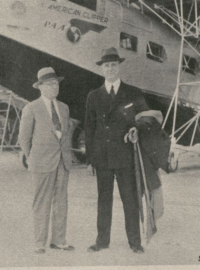 1933 Col. Sosthenes Behn Chairman of In'tl Telphone & Telgraph (on right) by beached Sikorsky S40 flying boat