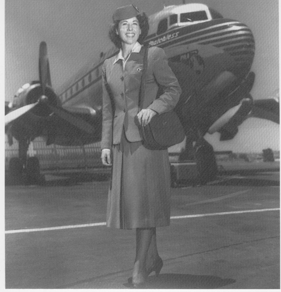 1940s  Flight Attendant  Fran Walker Brown posing by a DC4.