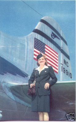 1940s  A Stewardess poses by the tail of aircraft NC19910 A Boeing 307