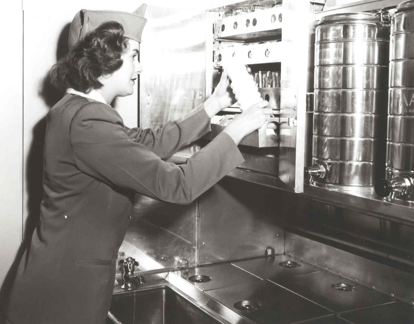 1940s A Stewardess working  in the galley of a Lockheed Constellation.