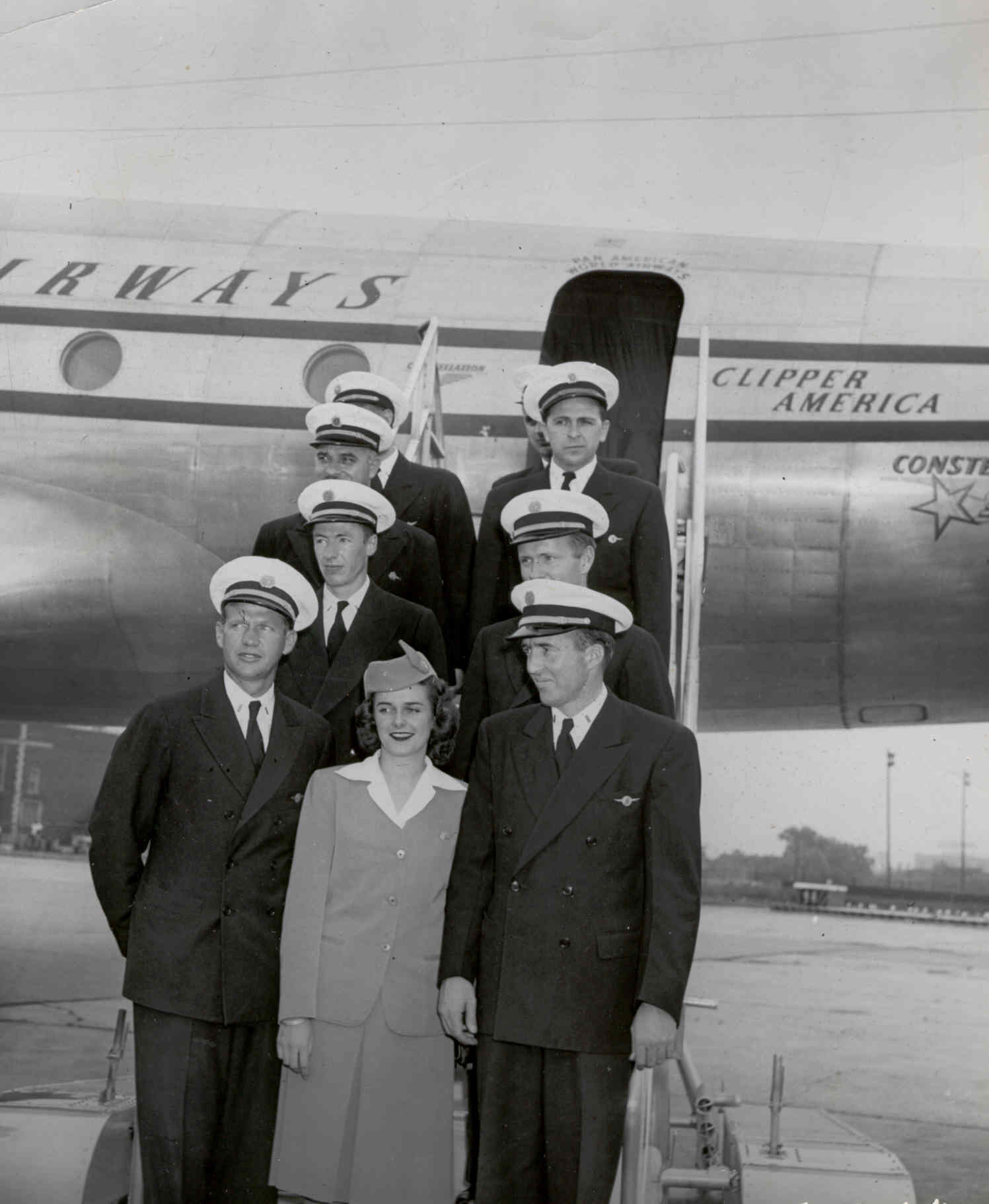 1940s A Pan Am crew pose on the steps of a Lockheed Constellation.