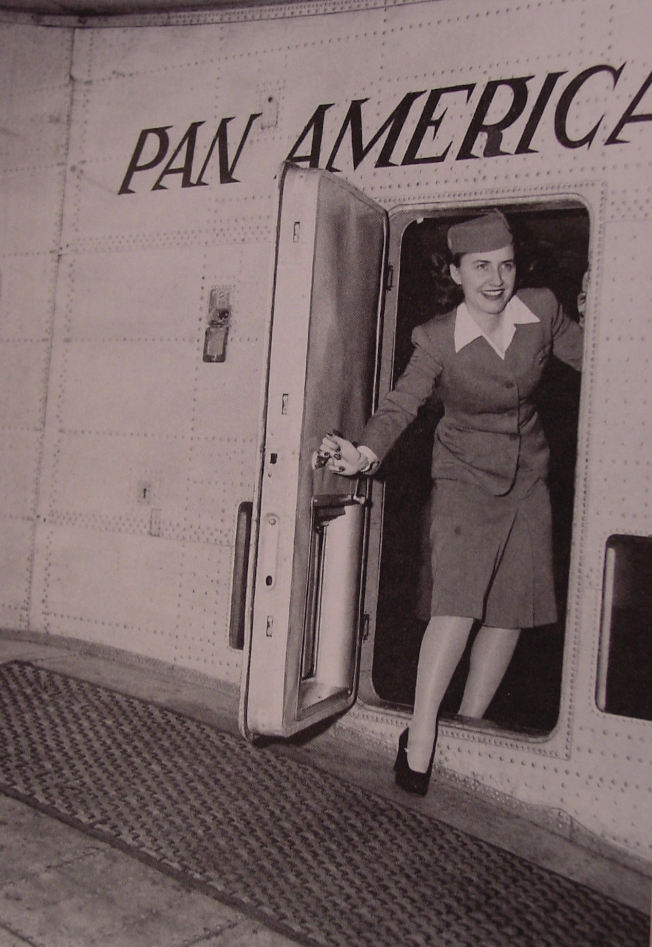 1940s Pan Am's first Stewardess, Madeline Cuniff in the doorway of a Boeing 314 flying boat