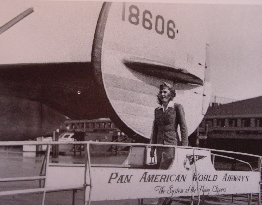 1940s Pan Am's first stewardess Madeline Cuniff boarding a Boeing 314 flying boat.