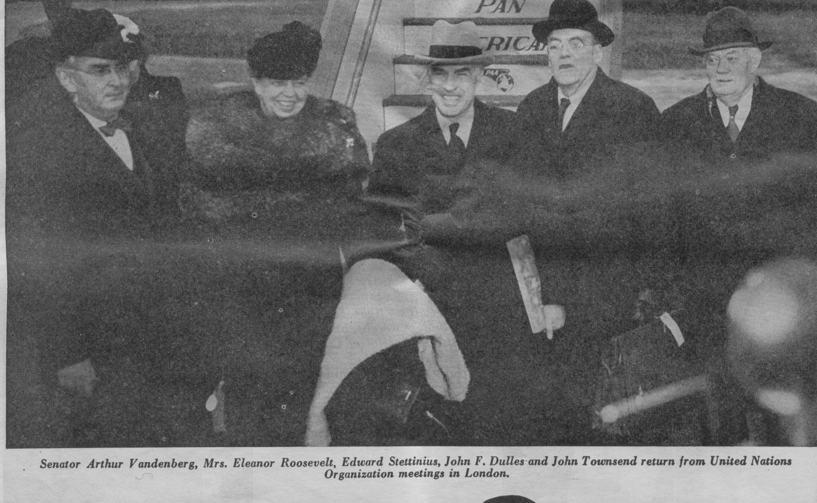 1946 Eleanor Roosevelt & party pose by Pan Am Clipper