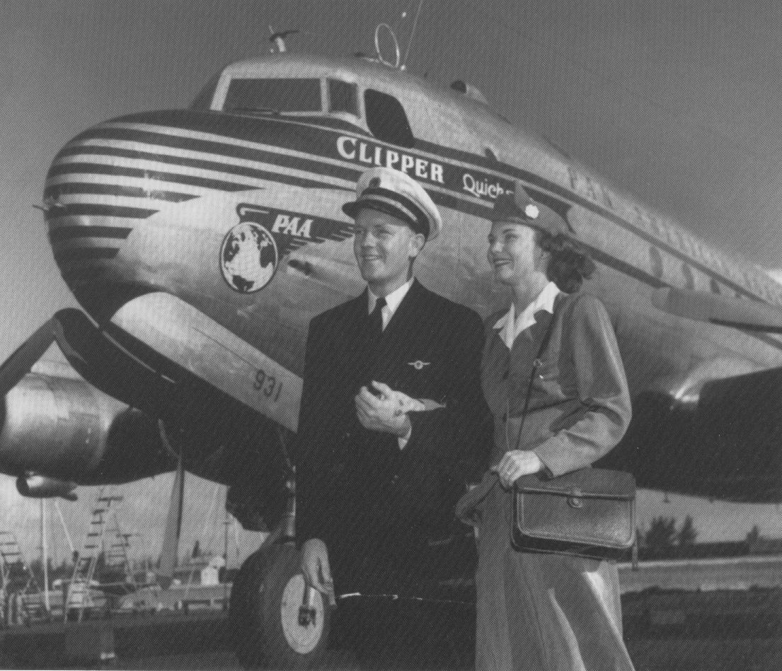 1948 Captain Conrad & Stewardess who were soon to become husband & wife pose by the nose of a Pan Am DC 4.  During that era getting married would have marked the end of the flying career of a stewardess - even if she did marry a captain.