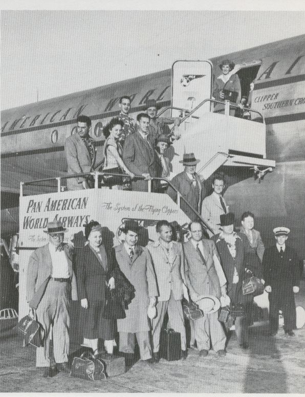1949 In Tokyo passenger pose on the aircraft steps.  Though already serving Tokyo for several years these customers were the first to arrive in Tokyo aboard the then new double decked Boeing 377
