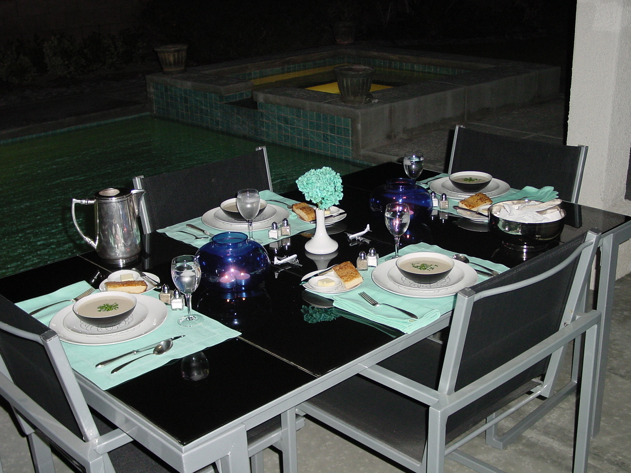 A poolside dinner setting with Pan Am's 1950s President Special setting with Rosenthal 'Script' plates.