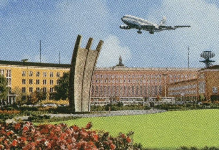 1960s A Pan Am 707 taking off from Berlin flies over a monument to the Berlin Airlift.