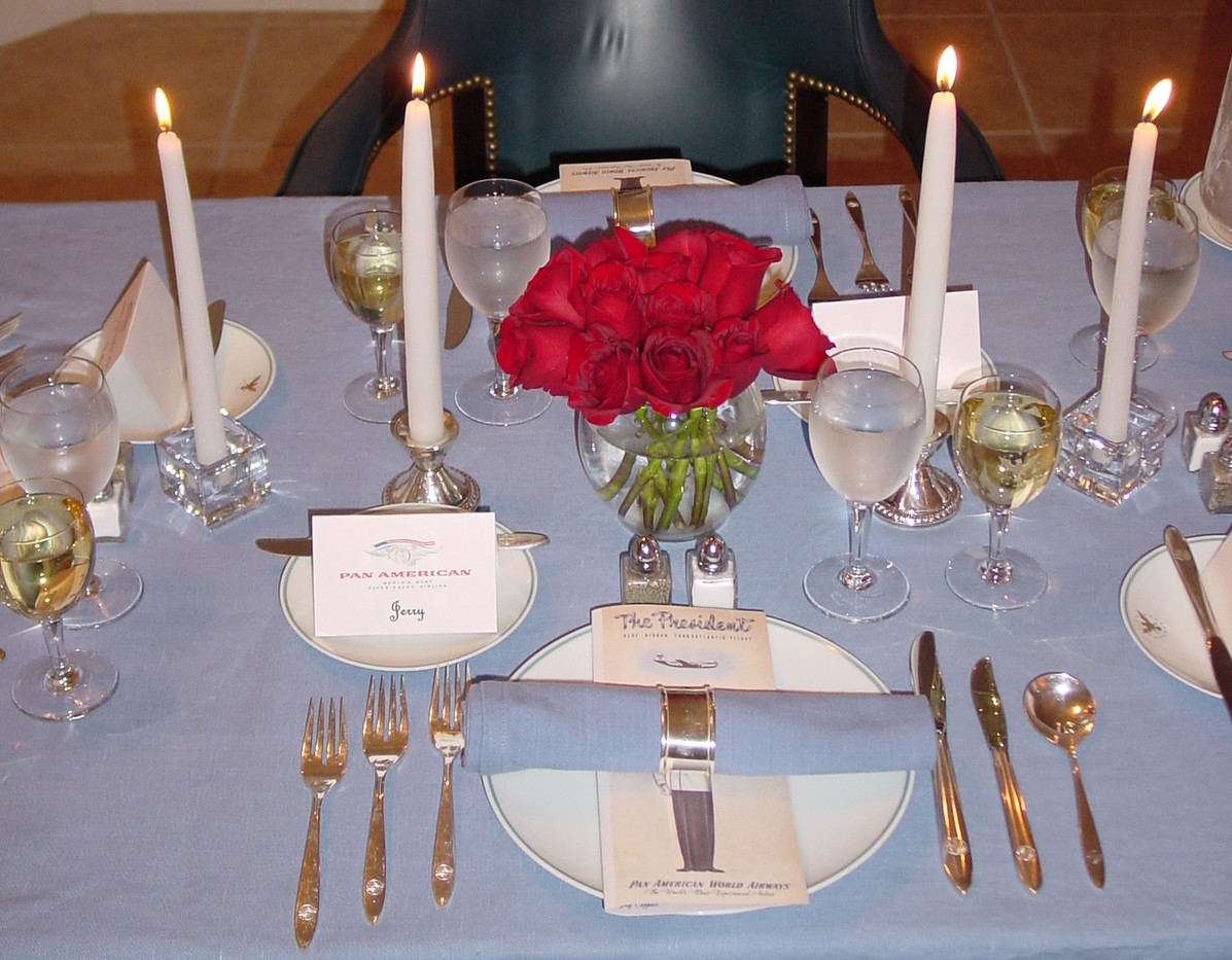 Red Roses and the 1960s Pan Am 'President' pattern by Noritake set this table.