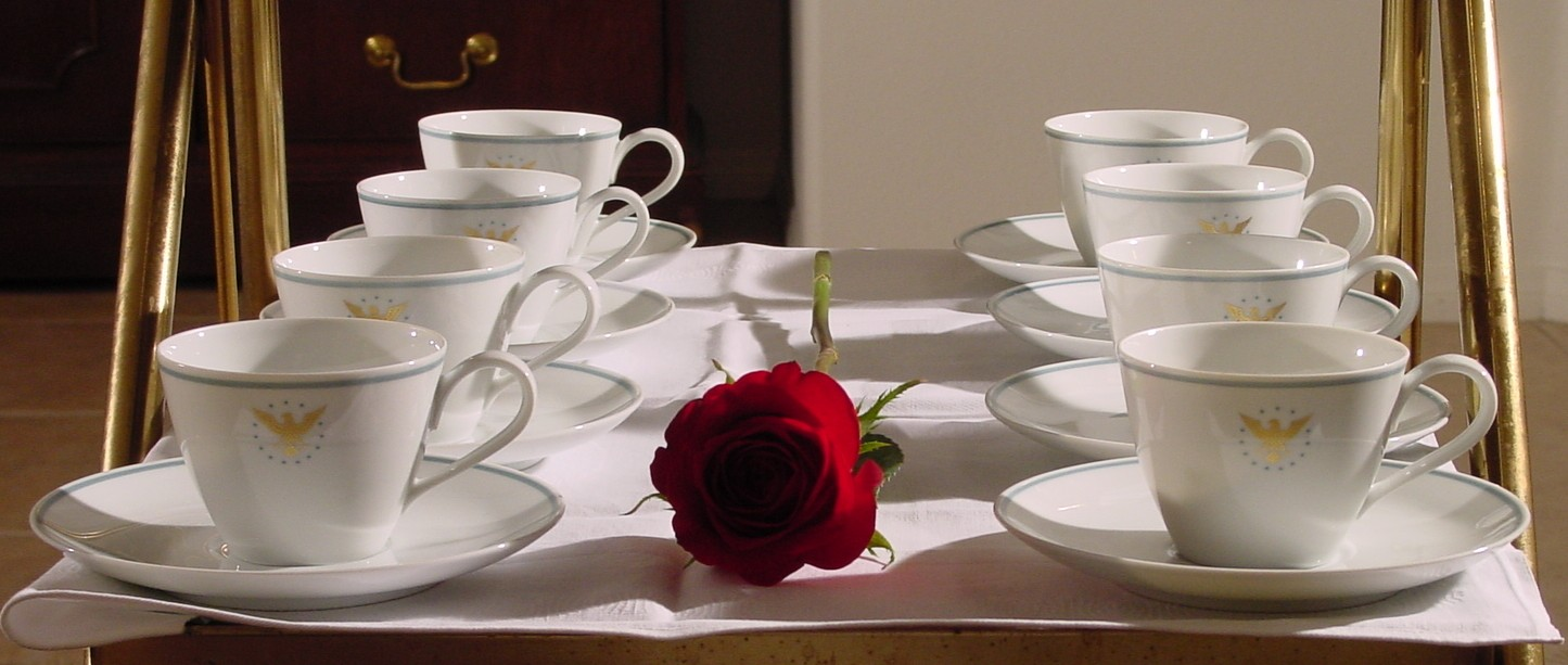 1950s The balck & white of the Rosenthal 'Script' cups are offset by a red rose on the coffee cart.