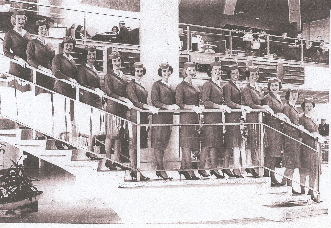 1963 Lynn Van Hoof-Werner, second from left, and colleagues pose for  the class Graduation photo  inside the Pan Am WorldPort passenger terminal at New York, Idlewild  Airport..