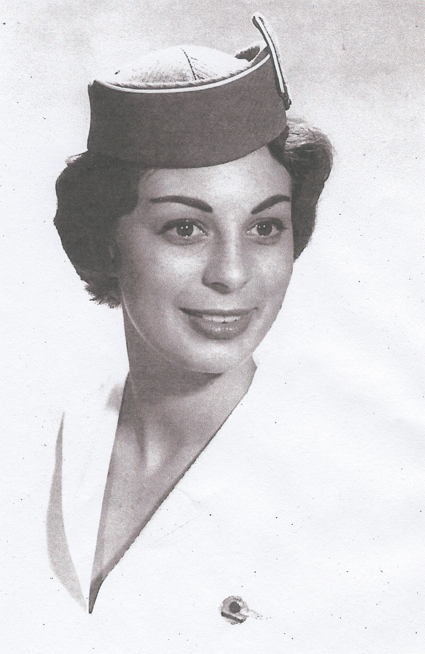 1963 Lynn Van Hoof-Werner in hat and blouse with wings.  During summer months and for travel to tropical climates  Flight Attendants were permitted to remove thier uniform jackets and wear their wings on their blouse.