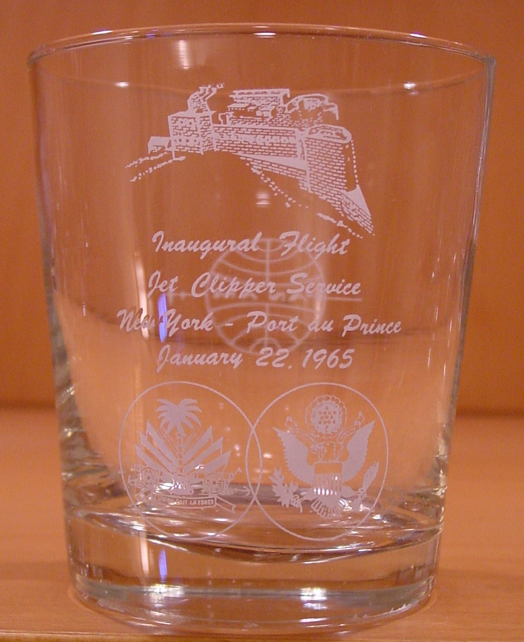 1965 January  22, A glass for the Inaugural jet flight from New York City to Port au Prince, Haiti.