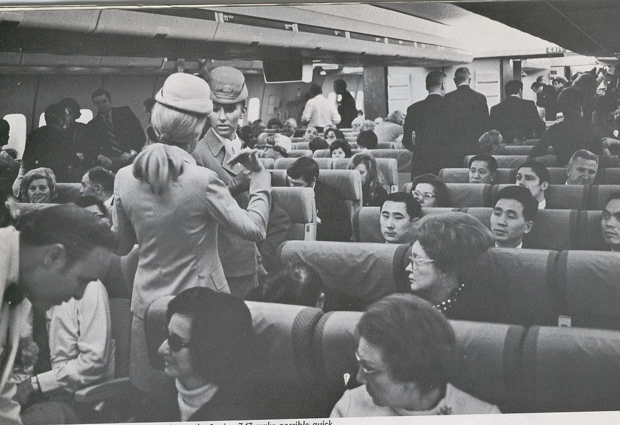 1970 Two Pan Am Flight Attendants  in the aisle of a 747.