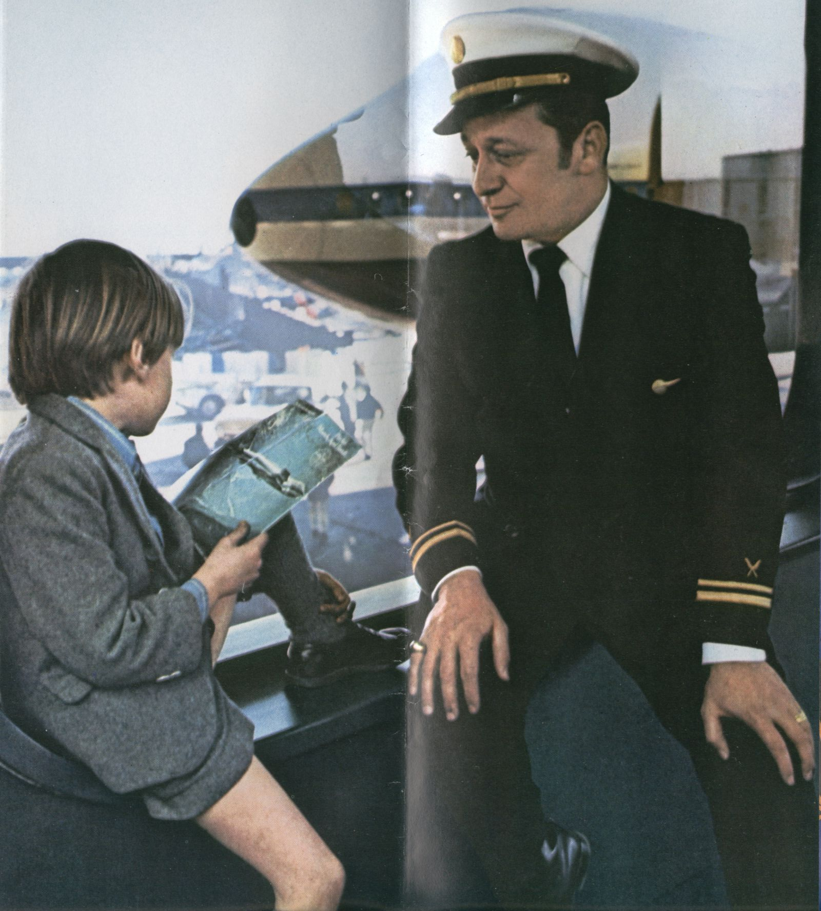 1970 When Pan Am introduced the 747 the crew compliment included a Flight Director to oversee all the flight attendants.  In this photo Flight Director Joe Pasquini speaks with a young passenger at Pan Am's WorldPort Terminal at New York JFK Airport.