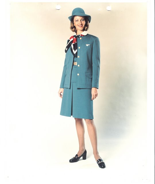 1970s Judy Skartvedt poses for a company publicity photo in her uniform created by Hollywood designer Edith Head .  Flight Attendants wore this uniform from 1975 to 1980.