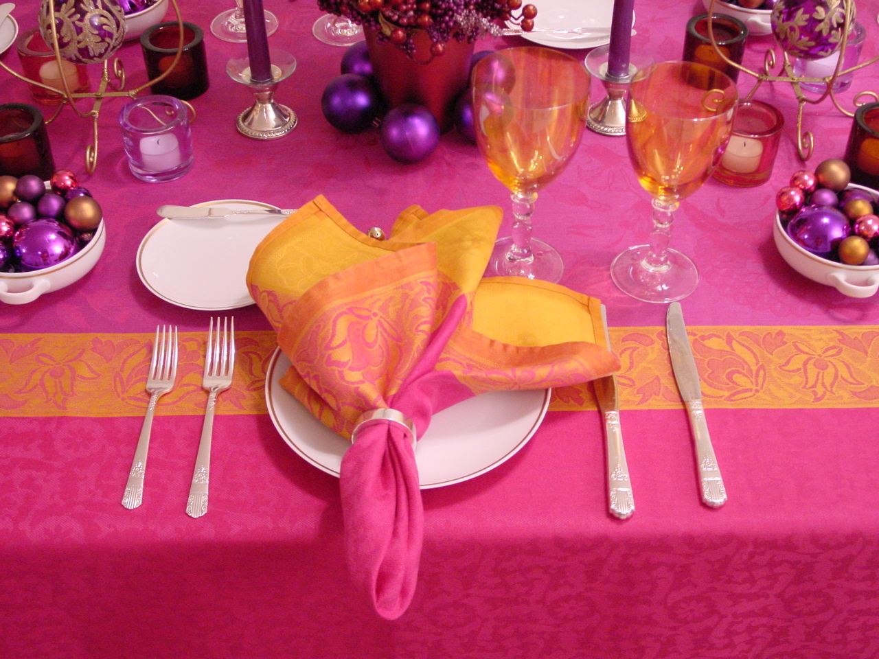 Pinks, purples and saffron are used with the 1970s 'Gold Rim' pattern to create an unusual holiday setting.