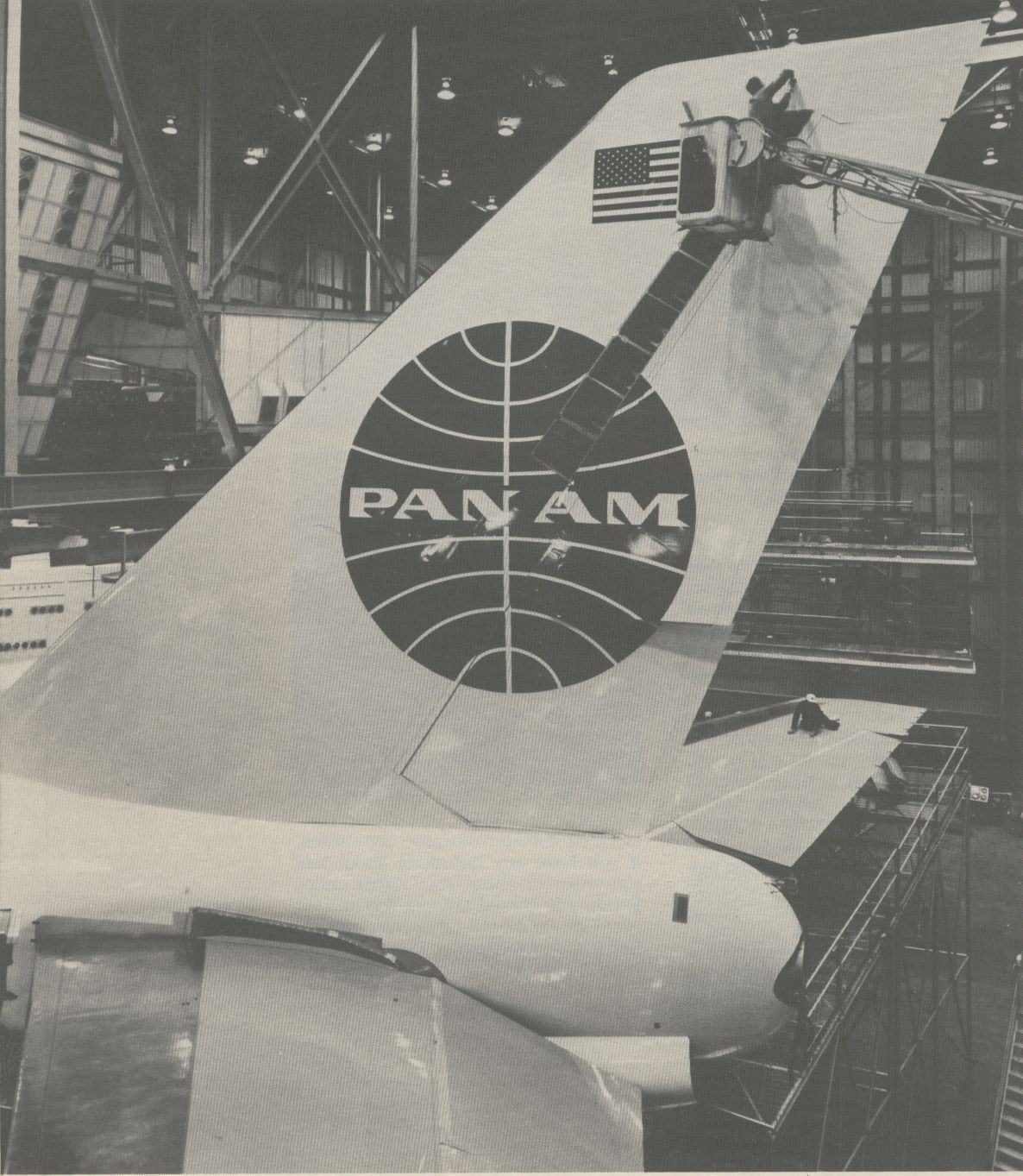 1970s  A Pan Am Boeing 747 in the hanger for maintenance.  The top of a 747 tail is as high as a six story building.