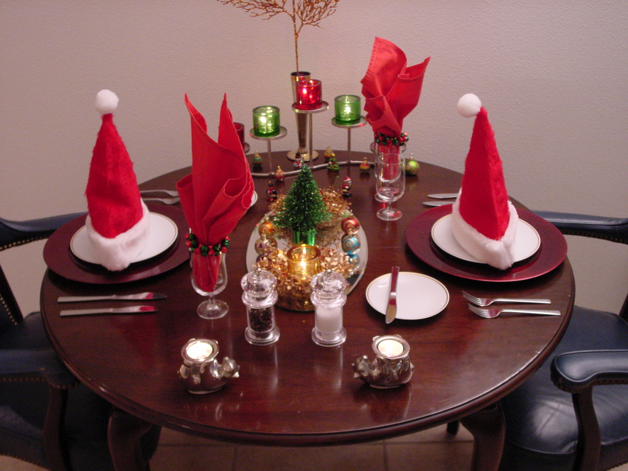 Santa hats and a mini Christmas tree and the 1970s 'Gold Rim' chiina pattern create the mood for this cozy holiday meal.