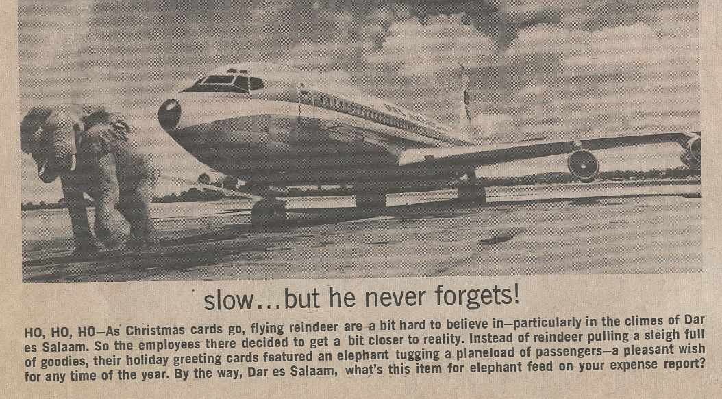 1971, April, An Elephant pulling a Pan Am Boeing 707 in Tanzania.