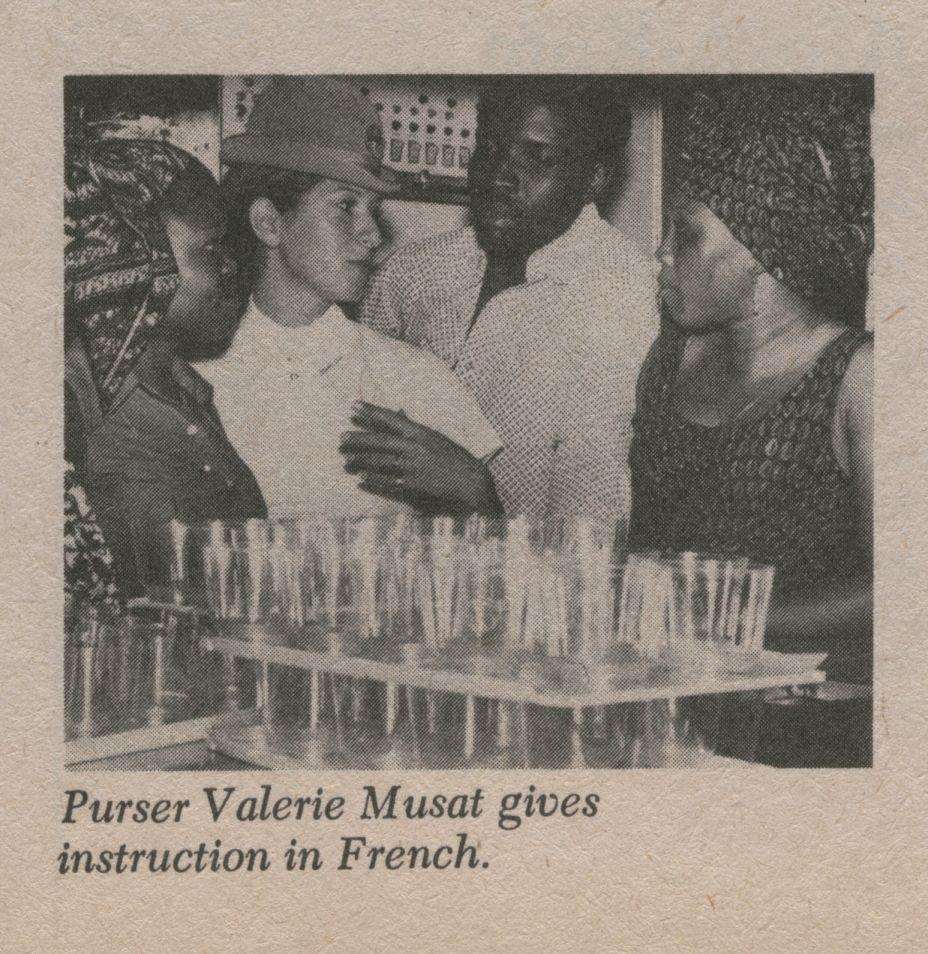 1974, Pan Am leased a 747 to Air Zaire for several years.  As part of the service contract Pan Am trained flight attendants for both safety and service.  Here a Pan Am Purser explains service procedures to Air Zaire trainees.