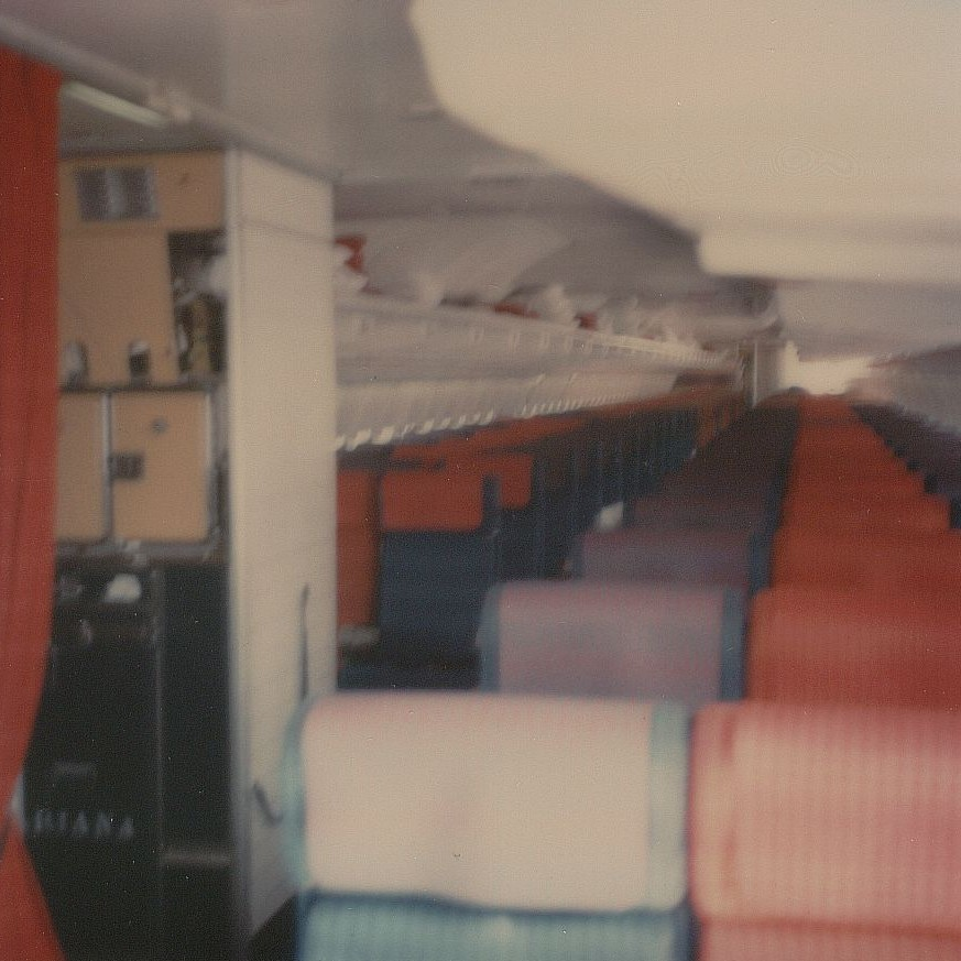August 1976 Interior shot of Pan Am Boeing 707 tail number N404PA.  This aircraft was in an all economy charter service configuration with 180 seats.