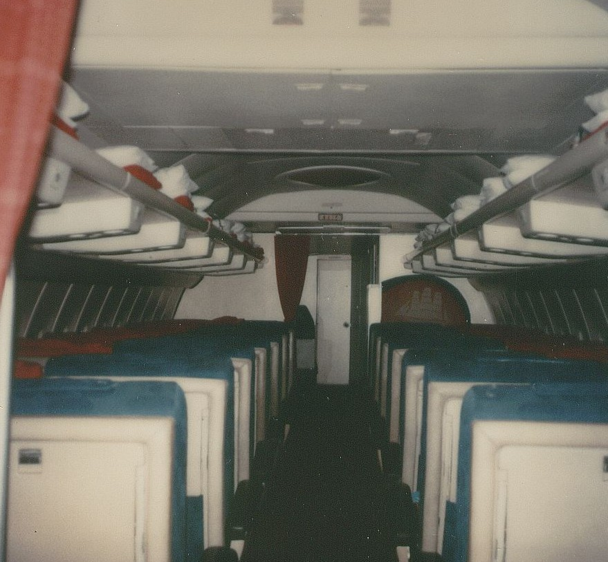 December 1978 a Pan Am Boeing 707 First Class cabin with 24 seats looking forward from the front of the economy section through First Class to the forward cockpit door.