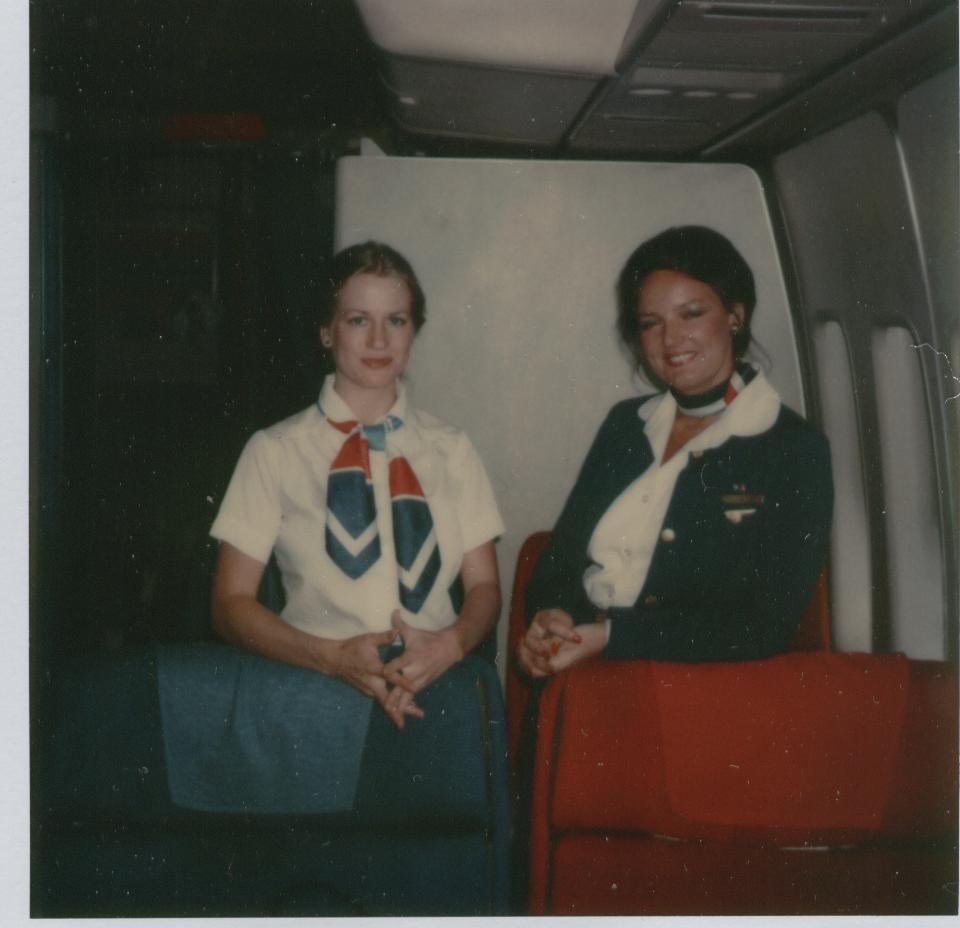 May 1979 Pan Am Purser, Claire Graham on right and colleague pose in the first class section of a Pan Am 747 at Washington Duller Airport.