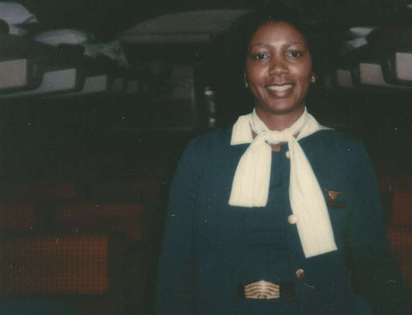 1979, January, Pan Am flight attendant Barbara Griffiths in the aisle of Boeing 707 tail number  N401PA Clipper Dauntless at Washington DC Dulles Airport.