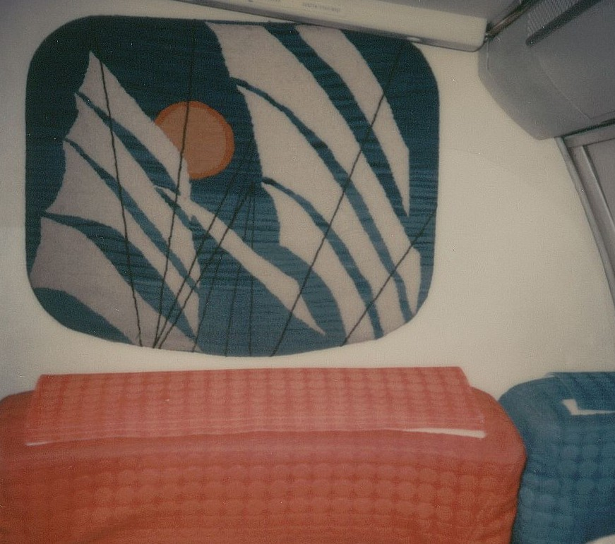 January 1979 economy class bulkhead artwork.  This fabric representation of a clipper ship's sails appeared on the right side bulkhead  behind first class at the front of the economy cabin.