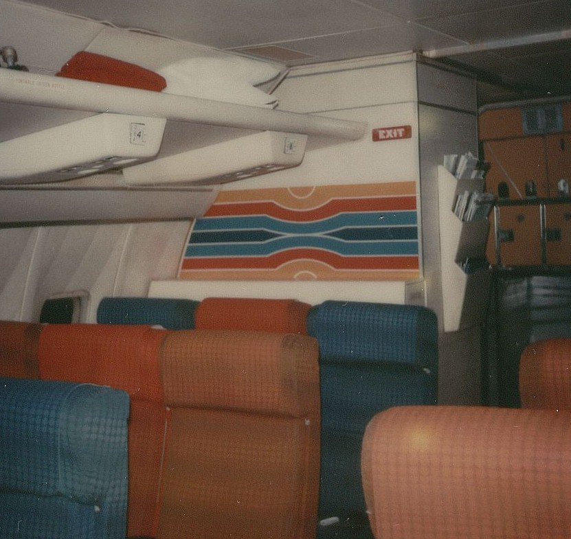 January 1979 the rear portion of the Economy Class cabin just forward of the right side rear galley on a Pan Am Boeing 707.