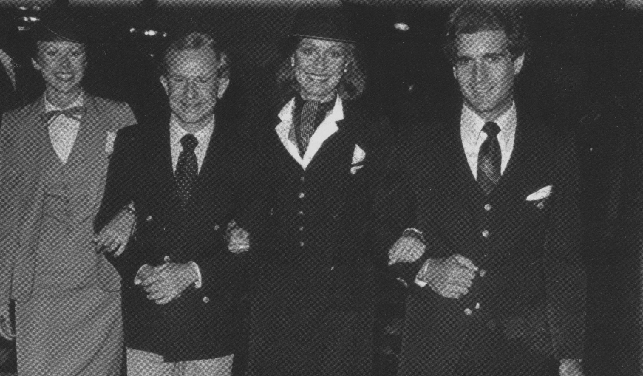 1980 Three Pan Am flight attendants pose with uniform designer Adolfo as he debuted their unifroms he designed exclusively for Pan Am.