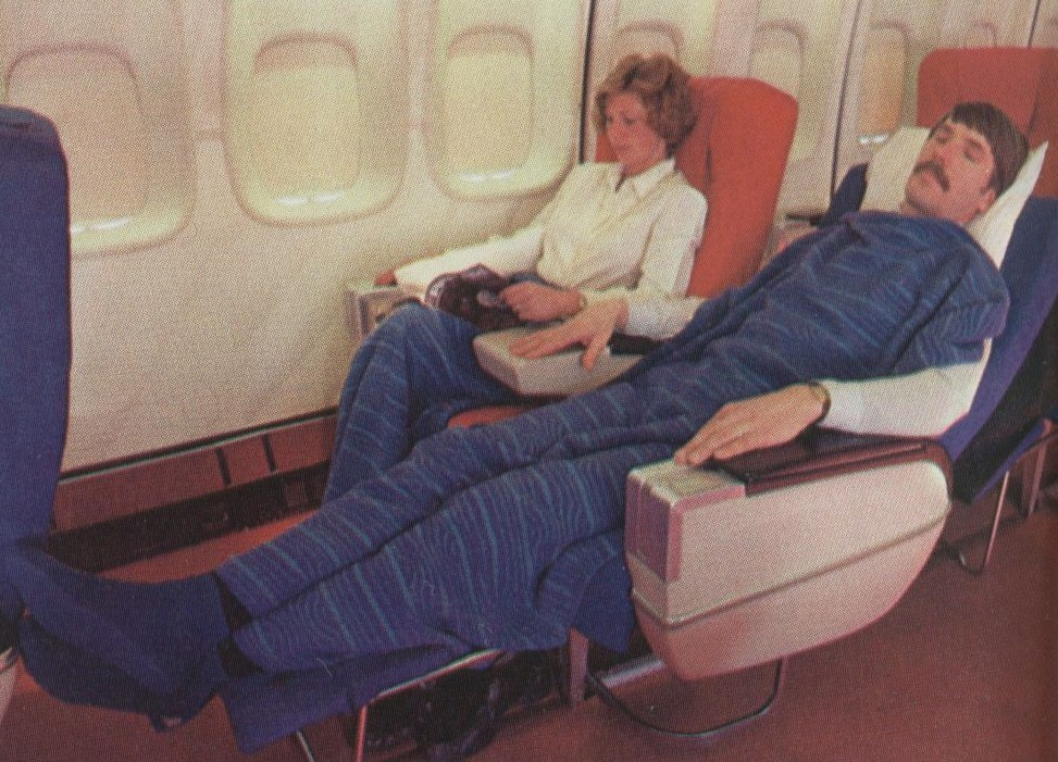 1980 Pan Am Passenger Service Agent, Al Donchenko, posing as a sleeping passenger for a publicity shot of Pan Am's Sleeperette seats in the First Class cabin of a Boeing 747SP.