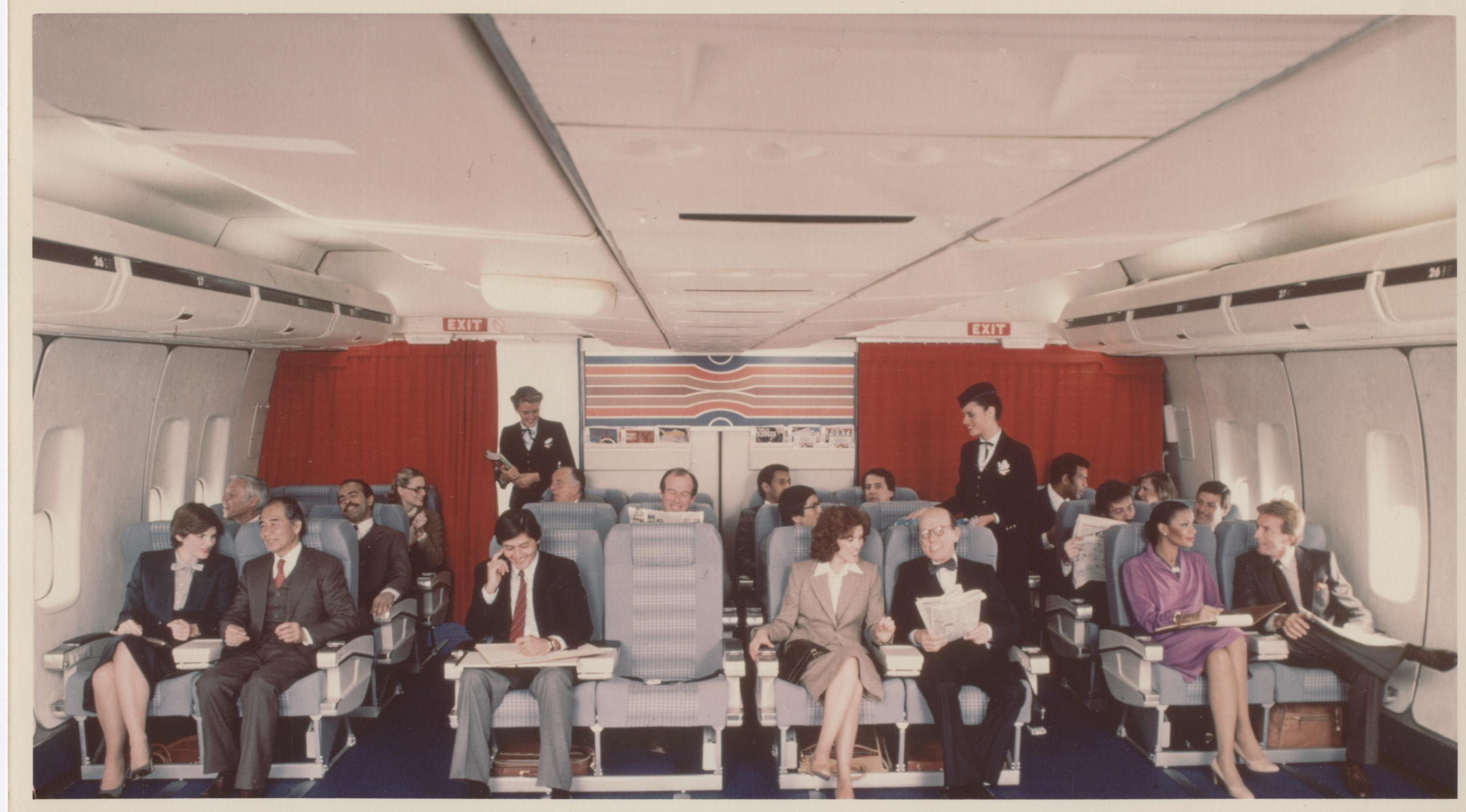 1980  When Pan Am first created Clipper Class (business class) the new cabin featured 8 across seating which was two less seats then in the Economy cabin.  Later Pan Am would convert to a 6 across cabin offering Clipper Class customers even more space.