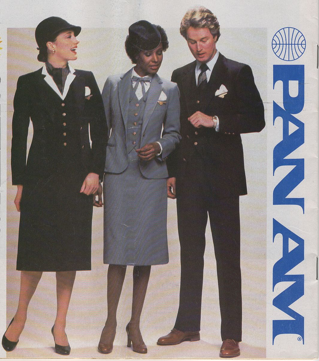 In July of 1980 Pan Am introduced new flight attendant uniforms designed fy popular 1980s designer Adolfo.  The uniform came in both navy & powder blue.  The uniform would be modified in the late 1980s with different blouses, ties, scarves and aprons.  At that time the powder blue option was discontinued.