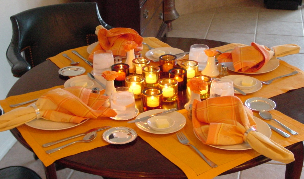 Candles and bright colors are combined with Pan Am's 1980s china pattern in this setting.
