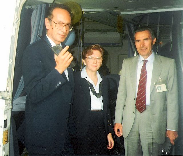1980s Purser, Peggy Catalano,  poses in the doorway of a Pan Am Boeing 747 with Rome Station Manger on her left and Rome Catering Manager (with radio) on her right.