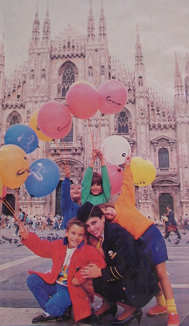1980s A Pan Am Purser poses with children in Milan.