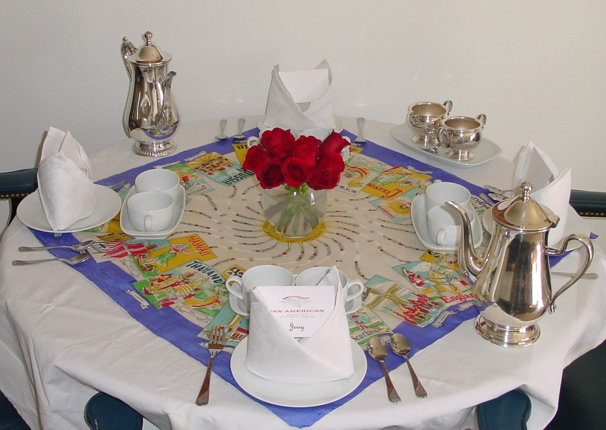 High Tea with the 1980s Pan Am china & silver service.  The colorful tablecloth is a silk ladies scarf (not issued by Pan Am) showing Pan Am jets and ports of call.