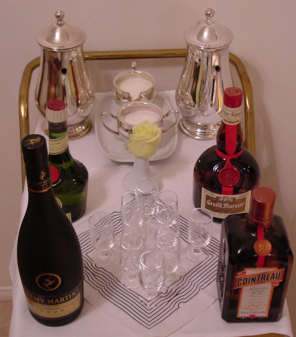 Coffee & liquor is offered from the cart with 1980s silver service and liquor glasses.