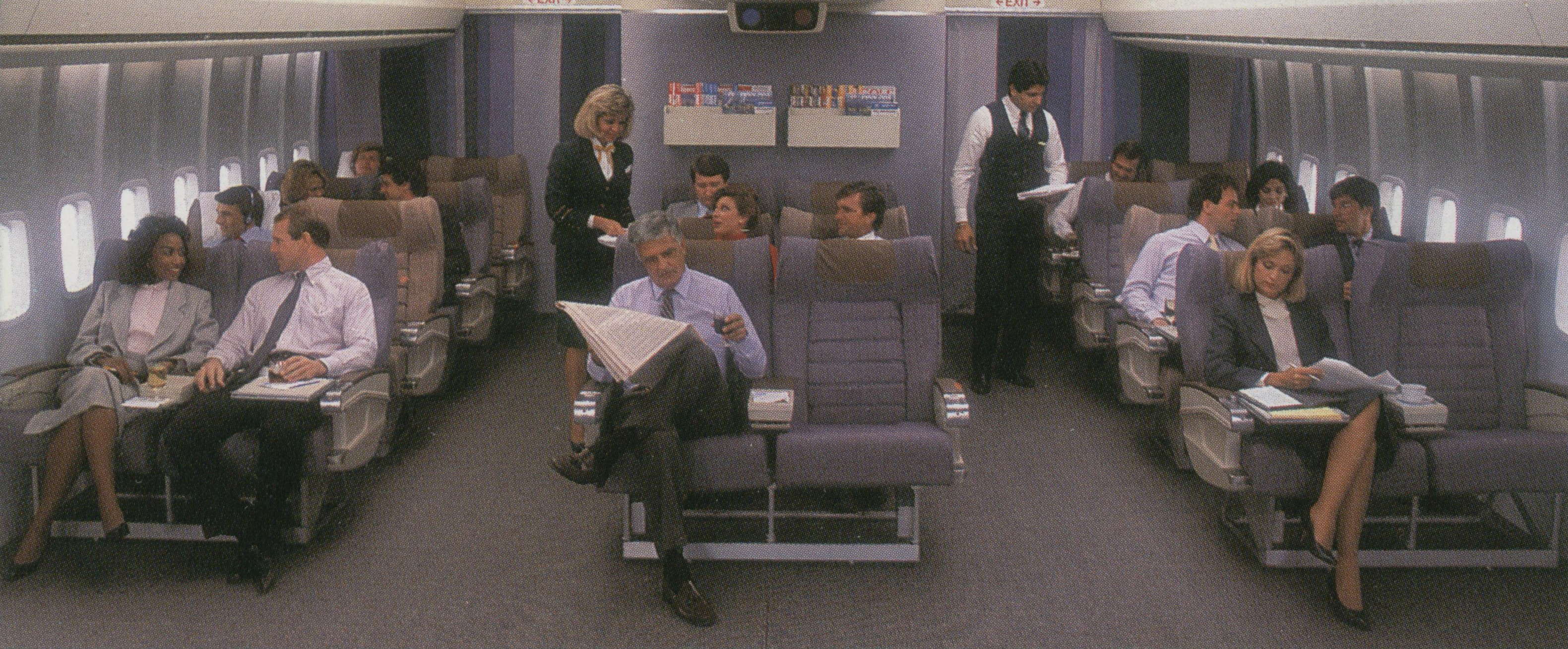 In the late 1980s Pan Am introduced a herringbone pattern for seat covers in Clipper Class (Business Class).  The coverings came in two colors blue and beige.  Both colors can be seen in this photo.