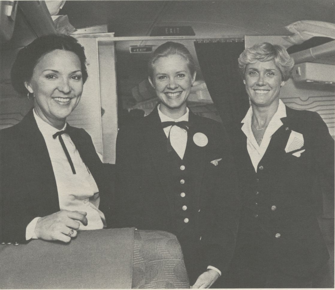 1981 Three Pan Am flight attendants pose in the first class cabin of a Boeing 727.