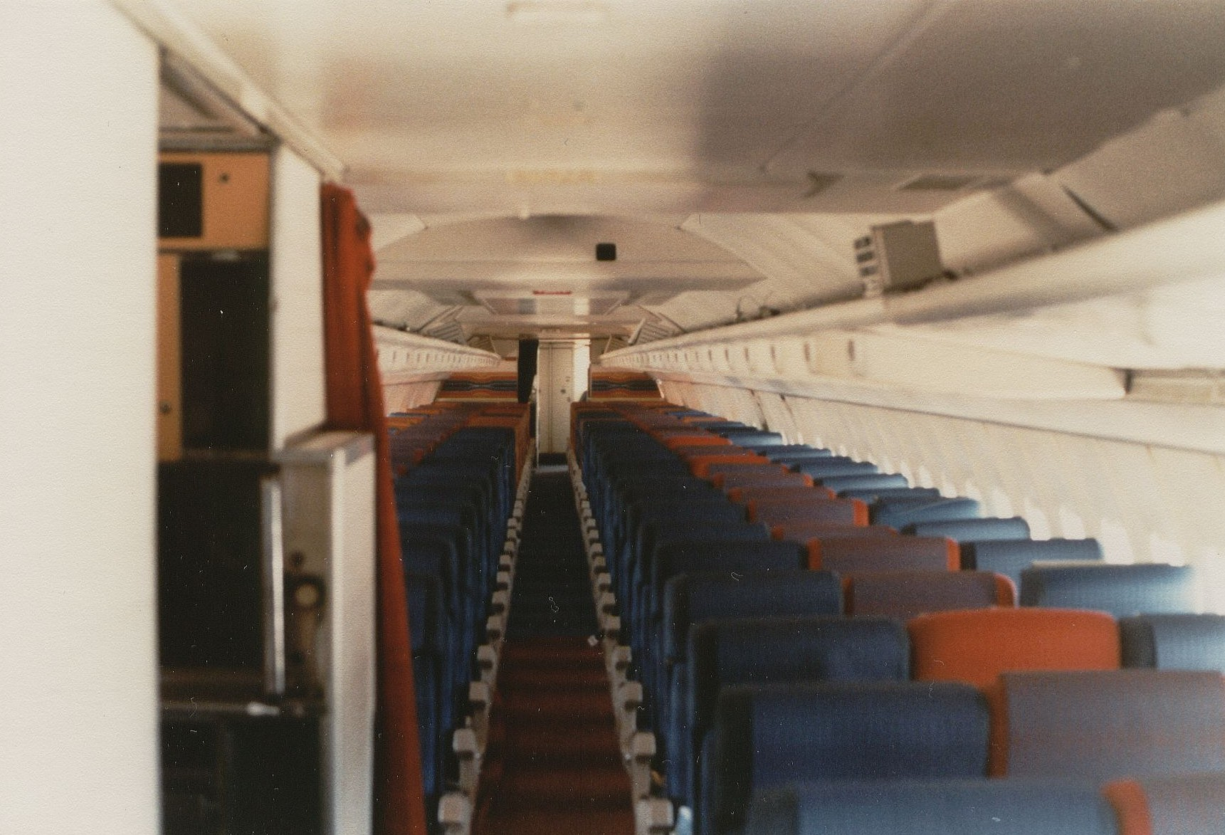 August 1981 A Pan Am Boeing 707 in an all economy charter service configuration with 180 seats.  This photograph was taken from the forward boarding door just by the cockpit and shows the whole cabin all the way to the rear lavatories.
