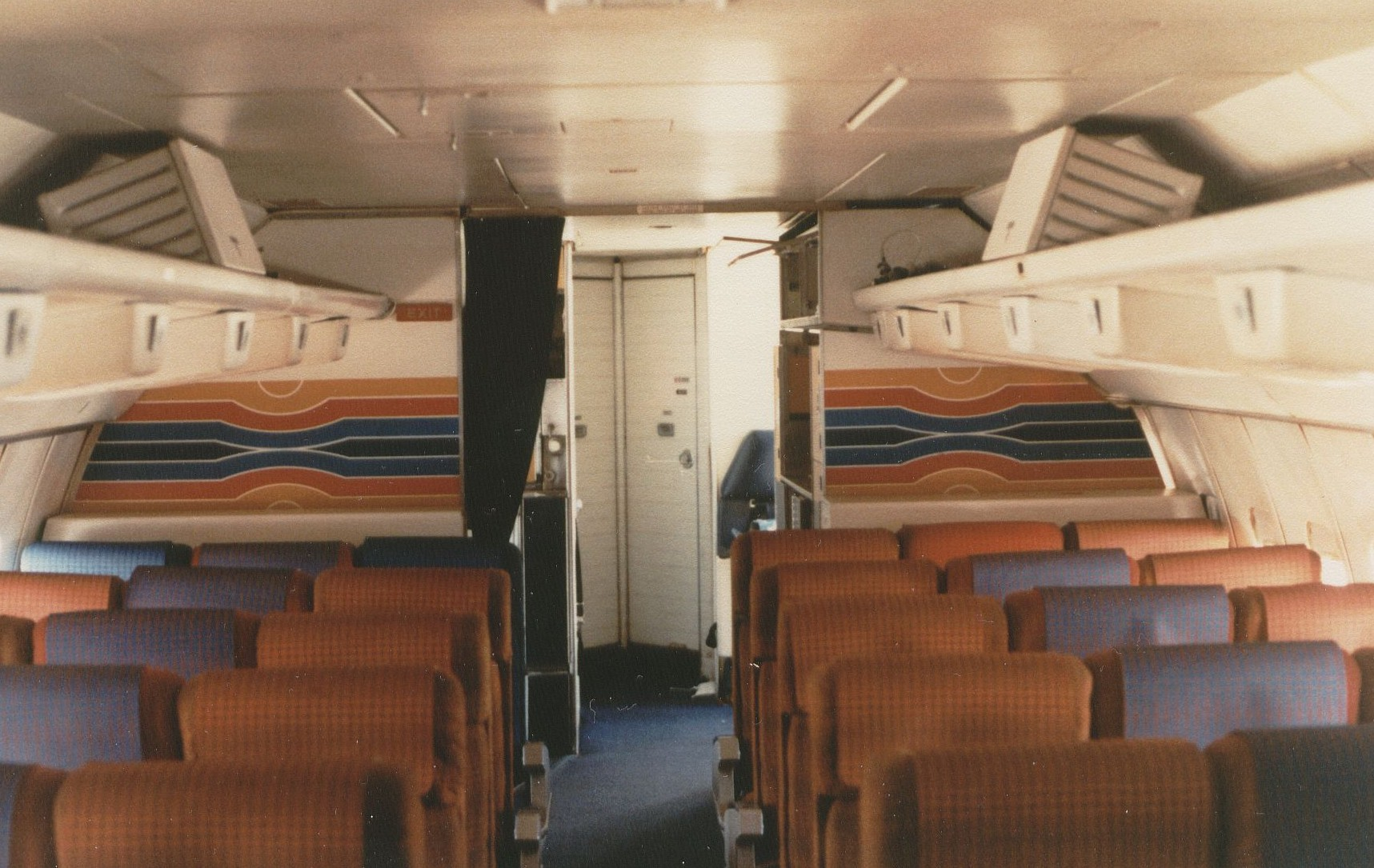 August 1981 The artwork on the rear bulkheads in the economy cabin of a Pan Am 707 were a stylized version of the famous Pan Am globe logo.