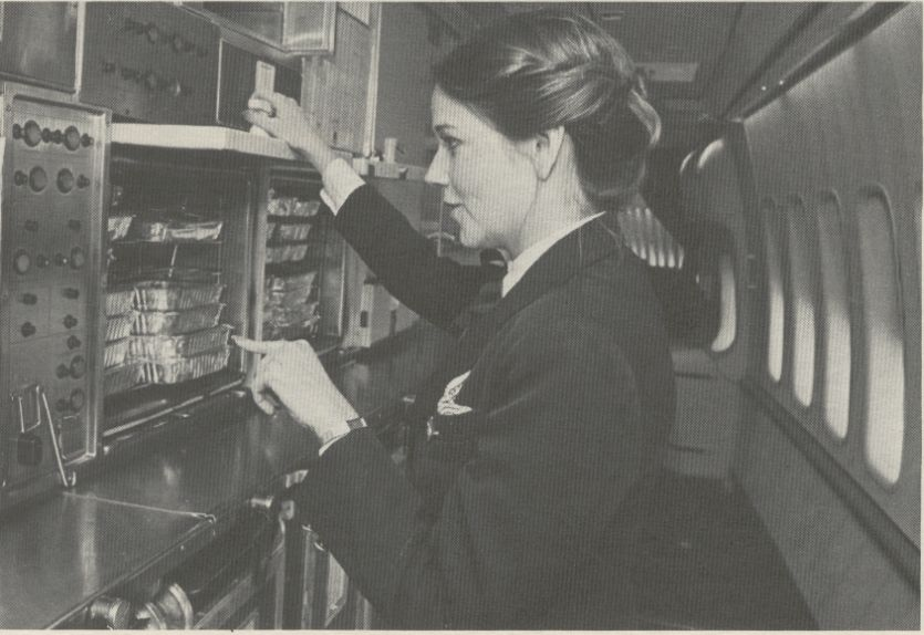 1981 A flight attendant performs a pre-departure galley check on a Pan Am Boeing 747SP.