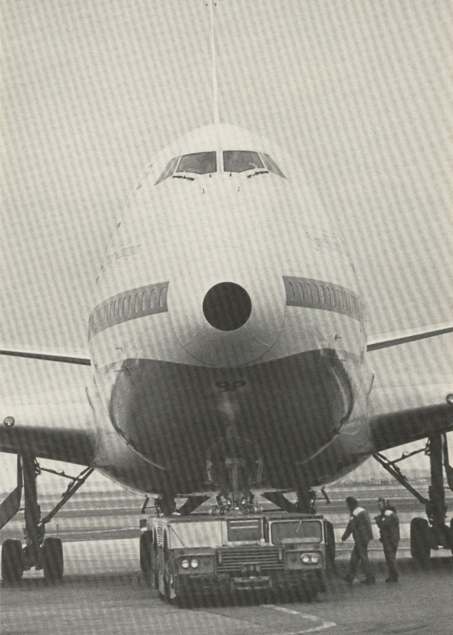 1981 A Pan Am 747 is being 'pushed back' from a gate.  A powerful tug was needed to move a fully loaded 747.