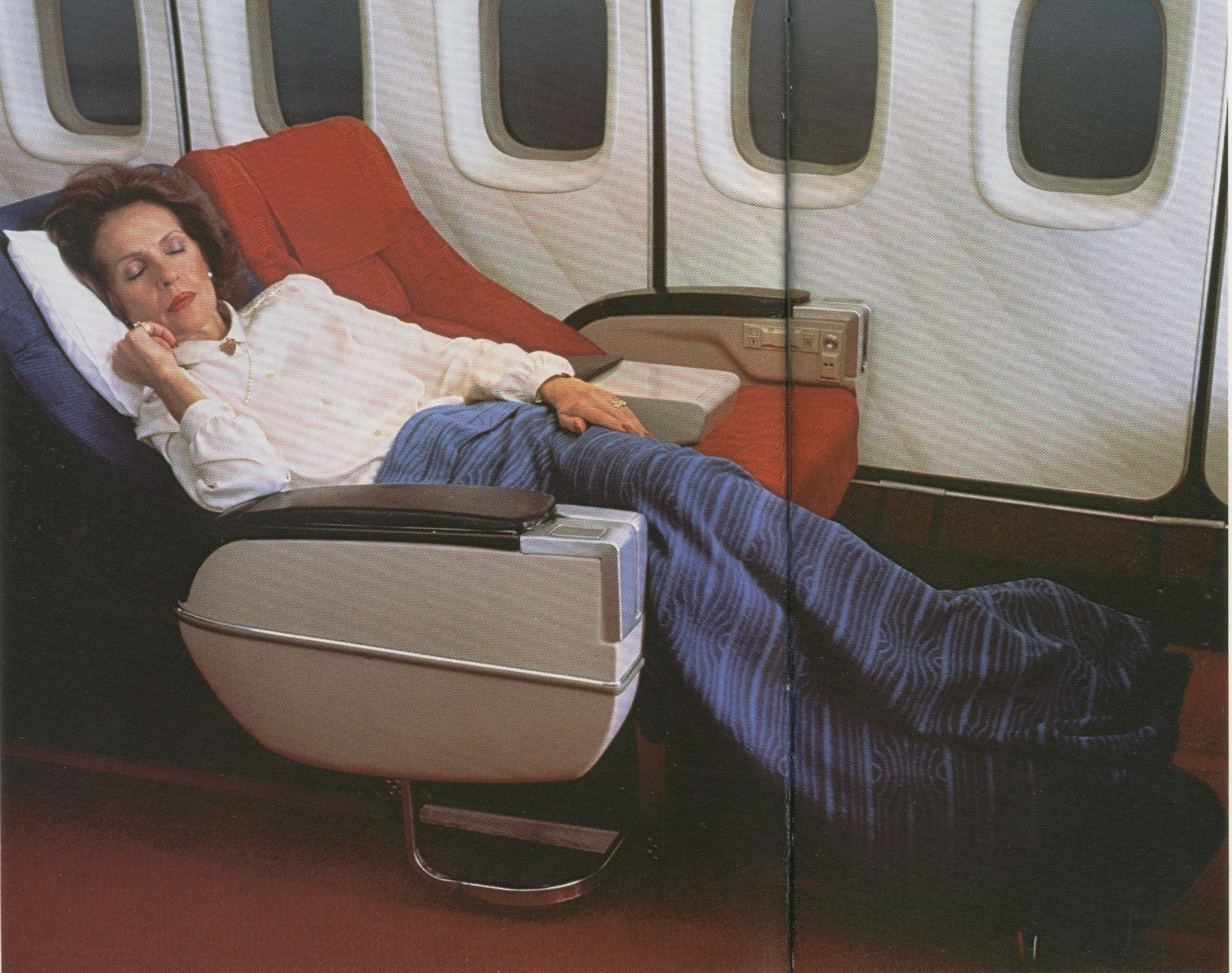 1981 A Pan Am customer slumbers in a Sleeperette First Class seat on a Pan Am Boeing 747SP.