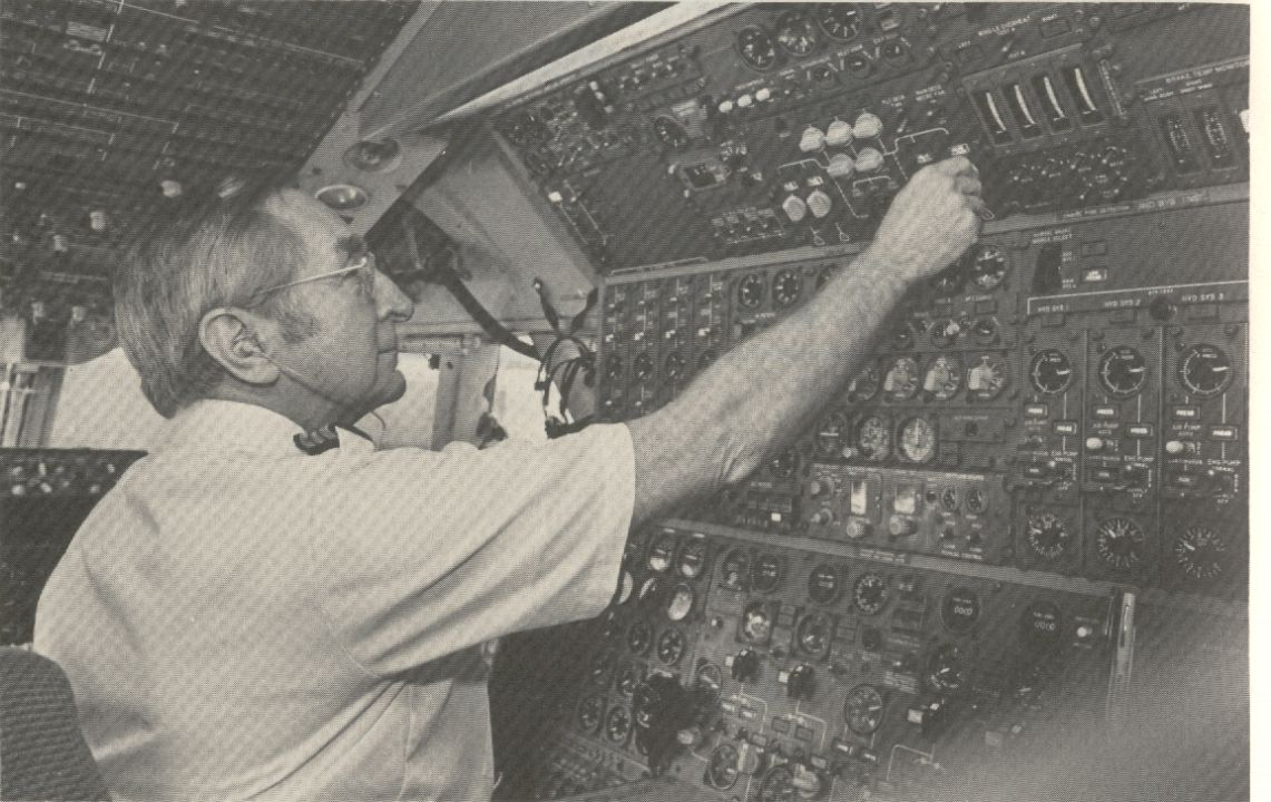 1981 A Flight Engineer at the engineers panel of a Pan Am Boeing 747.  Later versions of the 747 only require two pilots as the engineers function was incorporated into the pilot & co-pilots duties.